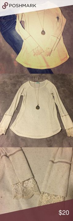 """Lace cuff, swing top Oatmeal blend long tunic with lace cuffs. I am 5'4"""" and it is tunic length for me. I'm comfortable wearing with leggings, as it goes long enough to cover my bottom. Please note: the lace on the cuffs is fairly tight. Great if you have smaller wrist but prevents you from pushing the sleeves up if you get warm. Worn a couple times. Great condition! Tops Tees - Long Sleeve"""
