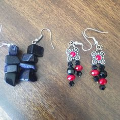 Two beautiful pairs of earrings. Two pairs of earrings purchased from boutiques. The first pair is blue goldstone which are black but sparkle with dark blue. The second pair is solve black and red/'Aron beads. These are both handcrafted and were never worn Jewelry Earrings