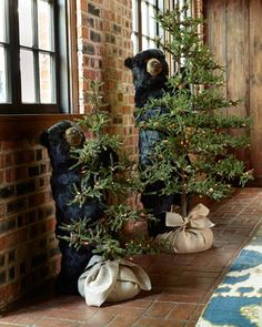 Tahoe Black Bear with Prelit Tree at Horchow .....with or without the bear these little trees are perfect for small families or homes and Mimi's. My grandchildren love my tree, small footprint and 6 ft tall. It remains decorated all year in a dust cover bag and slides into a storage closet. I add something new and special each year for me and the kids.  I decorate the house, pull out the tree, remove the bag, fluff out the branches, ribbons and ornaments and instant Merry Christmas :)
