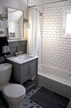 Bathroom - Small grey and white bathroom renovation update Subway tile, grey vanity, recessed cabinet, decorative tile, subway tile Diy Bathroom Remodel, Bathroom Renos, Bathroom Flooring, Bathroom Interior, Bathroom Remodeling, Bathroom Small, Bathroom Grey, Glass Bathroom, Basement Bathroom