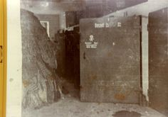 Dachau gas chamber, Germany, 30/04/1945, A door leading to the gas chambers, opposite a pile of clothes.