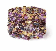 Gold filled woven bracelet with amethyst, red garnet, iolite, citrine, and freshwater pearls 7 1/2 inches--looks more like crochet to me