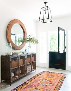 Dutch door in a gorgeous bright and airy entryway. Entryway table with large round mirror and vintage furniture. Decor, Home Decor Inspiration, House Design, Interior, Entryway Mirror, Room Redo, Home Decor, Inspiring Spaces, Interior Design