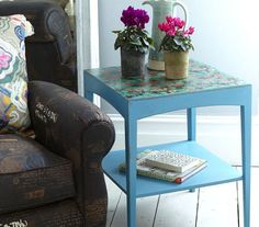 Transform a worn side table into a thing of beauty with rich paintwork and patterned paper. Find more upcycling projects at housebeautiful.co.uk