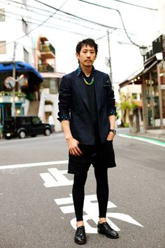 """Men wearing leggings under shorts, a very popular """"look"""" in Tokyo right now."""