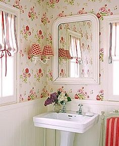 love the sconce with double red gingham shades and charming floral wallpaper and beadboard.  Charming!