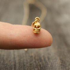 Tiny Gold Skull Necklace  Halloween Jewelry . Teeny by sevgicharms, $38.00