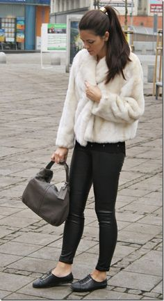 In the town in fur coat and sneakers
