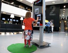 Interactive touch screen. A good idea to have it mounted on wheels so you can move it around.