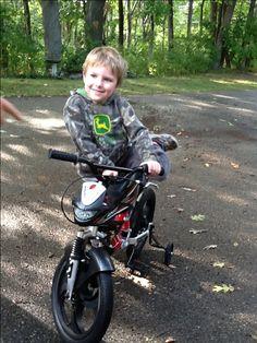 Jayden's first new bike we gave him