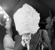 """Nina Leen's """"Unknown Woman Eating Cotton Candy"""". Love it."""