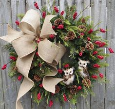 In this Christmas and wintertime wreath, a lovely burlap bow and a pair of adorable owls are the focal point. Beautiful greenery, berries, and pinecones make beautiful backdrop. This wreath is perfect for use during Christmas and through winter. This wreath was created using an artificial Canadian pine base measuring 23 tip to tip. Indoor/Sheltered Outdoor Safe *avoid too much direct sunlight as fading will occur over time  We create a wire loop on the back of the wreath for easy hanging…