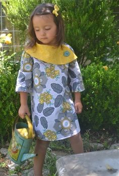 This modern, aline dress pattern features length sleeves and an over-sized collar. A coordinating button on the collar adds just the right touch. Collar continues around right shoulder and across back. Left shoulder uses velcro for closure. Sewing Terms, Sewing Patterns Girls, Clothing Patterns, Little Girl Dresses, Girls Dresses, Bow Dresses, African Dresses For Kids, Girls Tunics, Baby Sewing