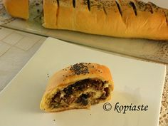 eliopita - greek traditional pie made in a loaf with olives, walnuts, feta and rosemary