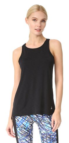 grace top by PRISMSPORT. Inset drawstrings cinch the side seams on this slinky jersey PRISMSPORT tank. The center back seam is divided into a ...