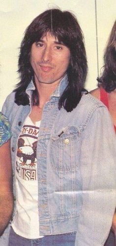 Steve Perry----Yes!  So good looking wow.
