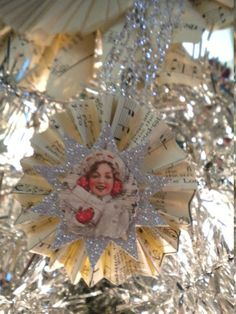 Vintage Sheet Music Paper Wheel Christmas Ornaments Set of 6. $9.95, via Etsy.