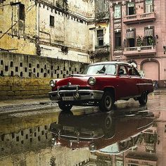 On a rainy day I ran into this old lady in the streets of #lahabanavieja #havana…