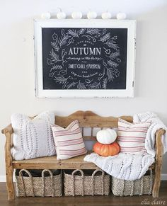 Bench with pillows and baskets underneath for storage