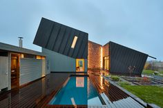 snøhetta's tilted zero energy house completed in norway