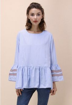 Casual yet chic is the order of the day with this blue top featuring girlish bell sleeves and solid blue stripes. Light embroidery gives the top a touch of boho chic without undermining the sharpness of the look.  - Blue and white stripe pattern - Flare cuffs with embroidered ribbon trimmed - Concealed back zip closure - Drop shoulder - Ruffle hem - 100% polyester - Hand wash  Size(cm) Length  Bust  Waist  Shoulder  Sleeves S/M        70    126   124    51       …