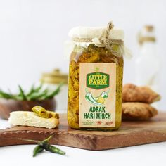 ____ Product Description: Green Chilli infused with the richness of Ginger and a pinch of Mustard. A must have in all Indian Kitchens, the conventional Adrak Hari Mirch pickle redefined. Adding flavour to any meal on the side.  Q Factor: The pickle is made in small batches without any preservatives and additives. All ingredients are freshly sourced from a farm and then sun-dried to maintain the traditional taste of the pickle.