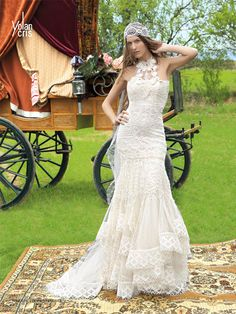 Hippie wedding dresses by YolanCris I hate the head piece but the dress is beautiful