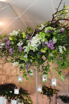 Suspended frame, draped with florals & greenery, hanging over the top of the long table. Open to suggestions re styles.