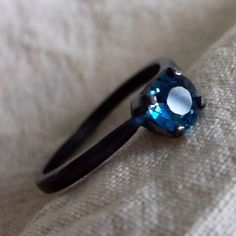 Blue topaz on an oxidized sterling silver band.
