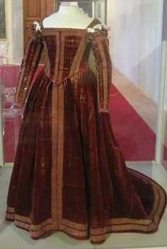 The Crimson Pisa Dress, Master Agostino (possibly): ca. early 1560's, silk velvet, wool, maline netting, bodice lined with linen, hem stiffening, various embellishments. The dress is on permanent display in Palazzo Reale in Pisa, Lungarno Antonio Pacinotti 46.