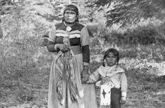 An unidentified mother and her son, people of the Assiniboine Nation.  Circa 1910. No location or additional information.