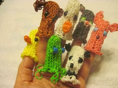 """Finger Puppets (see Finger Puppet Pictorial posted here also) - Cheryl Mayberry created the """"Oogaly Finger Pupper"""" pattern (the green one with the blue eyes) and it gave me a base to create my Finger Puppets pictured here. I doubled the bands going across the top of the head and added the animal features'. The dog's ears and cat's ears are from DIYMommy's Puppy and Cat charm. The Bunny ears are a lengthened version of MarloomZ Creations Bunny's ears. I also created a even bottom to the…"""