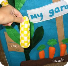 Felt card table playhouse with pickable vegetables and flowers! Likes the garden that you can interact with and pick the felt vegetables