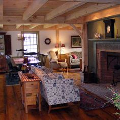Keeping and Dining room with Wide Pine Flooring And Timberframe Ceiling