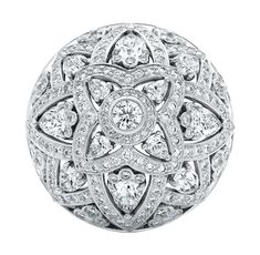 Diamond Lotus Ring 12 pear-shaped diamonds and 248 round brilliant diamonds weighing a total of 4.62 carats; platinum setting.