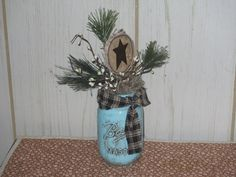 Blue jar with star by Joan Larson