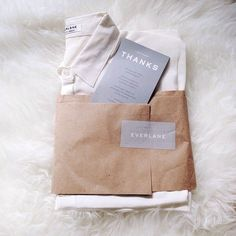 Everlane apparel and clothing packaging design Clothing Packaging, Fashion Packaging, Clothing Labels, Fashion Branding, Scarf Packaging, Print Packaging, Simple Packaging, Packaging Ideas, Label Design
