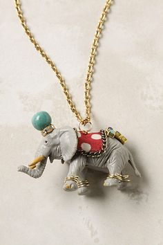 """Party Animal Necklace All decked out and donning the finest bits and baubles, this circus-escapee is in for hours of merriment at the wildest ball in town. Lobster clasp 24k gold plated metal, Swarovski crystal, cotton, glass, plastic, limestone 32""""L Giraffe: 3"""" pendant Elephant: 1.75"""" pendant Tiger: 1.75"""" pendant Zebra: 2.5"""" pendant USA Style #: 20753232"""
