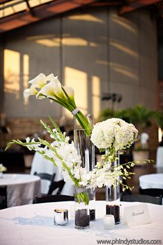 Modern calla, hydrangea and orchid centerpieces. Photo by Phindy Studios