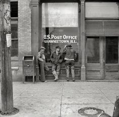 April 1937:  Shawneetown, IL.  Love the man's pants on the left.