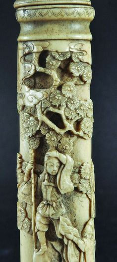 A FINE QUALITY JAPANESE BONE IVORY TANTO, carved in good detail with scenes of samurai, pine and cloud scrolls, 10.8in long.