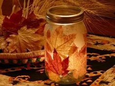Mod podge fall leaves to the outside of a cleaned mason jar, and drop a tea light in.