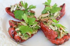 Raw marinated pepperboats, eggplantpesto, basilpesto and spiced almonds