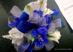 corsage | white mini roses, blue orchids, white lisianthus, with blue and gray ribbon