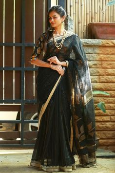 Want to know how to style your traditional black sarees in most perfect way? Do check out these inspiring sarees styles. Indian Sarees, Silk Sarees, New Dress Design Indian, Saree With Belt, House Of Blouse, New Designer Dresses, Black Saree, Saree Styles, Cotton Saree