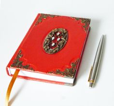 #Red genuine leather #notebook diary with an antique floral bronze ornament in the middle, and with bronze corners. It's unique gift for #bestfriend, #sister, mom... Handmade Notebook, Notebook Ideas, Leather Gifts, Leather Books, Leather Notebook, Leather Journal, Customized Gifts, Personalized Gifts, Creative Notebooks