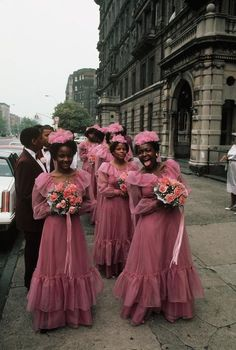 New York City. 1983. A wedding party with bridesmaids on Fifth Ave in Harlem by Thomas Hoepker