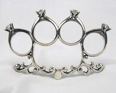 Keep your husband in line with this classy knuckle duster! I WANT!!!!!