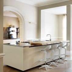 A masterclass in blending old and new, this modern unit fits beautifully into the classical setting of this north London home by Numero 5 Interiors (numero5interiors.com). Its off-white colour and solid wood breakfast bar complement the property's period details