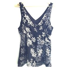 Black floral blouse Has elastic under the bust.  New with tags and lined with sheer fabric.  Shades of grey, taupe and cream New York & Company Tops Blouses
